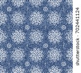 vector jeans background with... | Shutterstock .eps vector #702441124