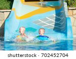 two brothers in an inflatable... | Shutterstock . vector #702452704