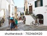 ostuni  italy   july 31  2017 ... | Shutterstock . vector #702460420