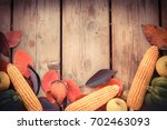 autumn background with green... | Shutterstock . vector #702463093