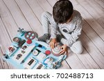 cute toddler baby playing with... | Shutterstock . vector #702488713