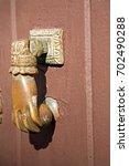 door knocker hand shaped door... | Shutterstock . vector #702490288
