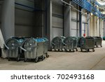 Containers With Used Bottles O...