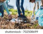 volunteering  people and... | Shutterstock . vector #702508699