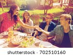 leisure  holidays  eating ... | Shutterstock . vector #702510160
