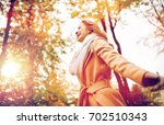 season and people concept  ... | Shutterstock . vector #702510343