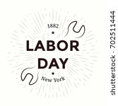 labor day emblem. isolated...   Shutterstock .eps vector #702511444