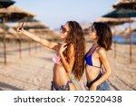 two sexy girls taking selfie on ... | Shutterstock . vector #702520438