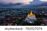 'golden mountain '  wat saket... | Shutterstock . vector #702527074