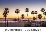 manhattan beach pier at sunset  ... | Shutterstock . vector #702538294