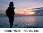 traveler girl enjoying sunset...   Shutterstock . vector #702552130