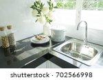 bright white modern kitchen... | Shutterstock . vector #702566998