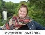 down syndrome young adult... | Shutterstock . vector #702567868