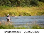 man fishing in chilkat river in ... | Shutterstock . vector #702570529