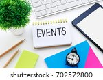notebook with events word on... | Shutterstock . vector #702572800