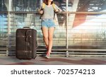 asian woman traveler with... | Shutterstock . vector #702574213