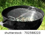 barbecue grill outdoors | Shutterstock . vector #702588223