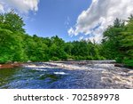 river flowing through the... | Shutterstock . vector #702589978