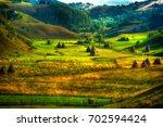 mountain landscape with autumn...   Shutterstock . vector #702594424