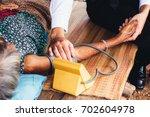 male doctor listening heart... | Shutterstock . vector #702604978