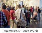 closeup queue of europen people ... | Shutterstock . vector #702619270