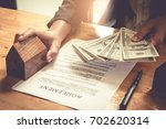 businessman hand and contract...   Shutterstock . vector #702620314