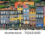 facades at the ribeira  the... | Shutterstock . vector #702631600