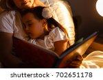 little daughter fell asleep at...   Shutterstock . vector #702651178