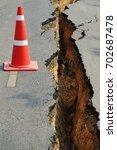 road cracked and broken | Shutterstock . vector #702687478