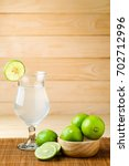 lime or lemon juice with wood... | Shutterstock . vector #702712996