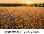 top view. a farmer  his wife... | Shutterstock . vector #702723028