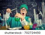 smart boy scientist making... | Shutterstock . vector #702724450