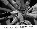 hands together  | Shutterstock . vector #702731698