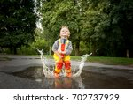 Child In A Yellow Waterproof...