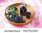 homemade chokeberry juice or... | Shutterstock . vector #702751390