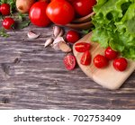 vegetable grocery on a wooden... | Shutterstock . vector #702753409