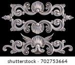 chrome ornament on a black... | Shutterstock . vector #702753664