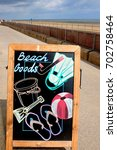 Small photo of Sutton-on-Sea, Lincolnshire, UK. August 19, 2017. A artistic sandwich chalkboard advertising beach goods on sale at a promenade shop on the seafront at Sutton-on-sea in Lincolnshire.