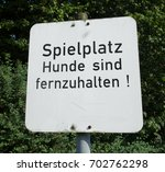 "Small photo of German sign ""Spielplatz - Hunde sind fernzuhalten"" (translation: Playground - Keep dogs out!)"