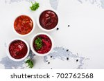 bowls of various tomato sauces... | Shutterstock . vector #702762568