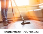 low section of man cleaning... | Shutterstock . vector #702786223