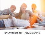 happy family in living room   Shutterstock . vector #702786448