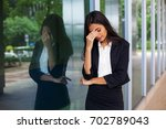 a stressed professional indian... | Shutterstock . vector #702789043