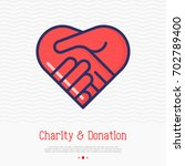 two hands in shape of heart... | Shutterstock .eps vector #702789400