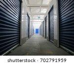rows of indoor storage units ... | Shutterstock . vector #702791959