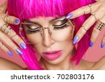 beautiful model in pink wig and ... | Shutterstock . vector #702803176