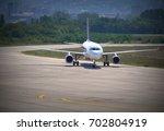 airplane landing   Shutterstock . vector #702804919
