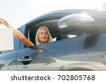 woman with shopping in car | Shutterstock . vector #702805768
