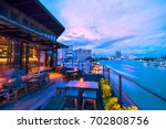 rooftop bar.overlooks the chao... | Shutterstock . vector #702808756