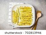 parmesan garlic squash wedges.... | Shutterstock . vector #702813946